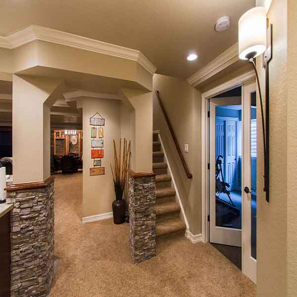 An added exercise room to a beautifully done basement