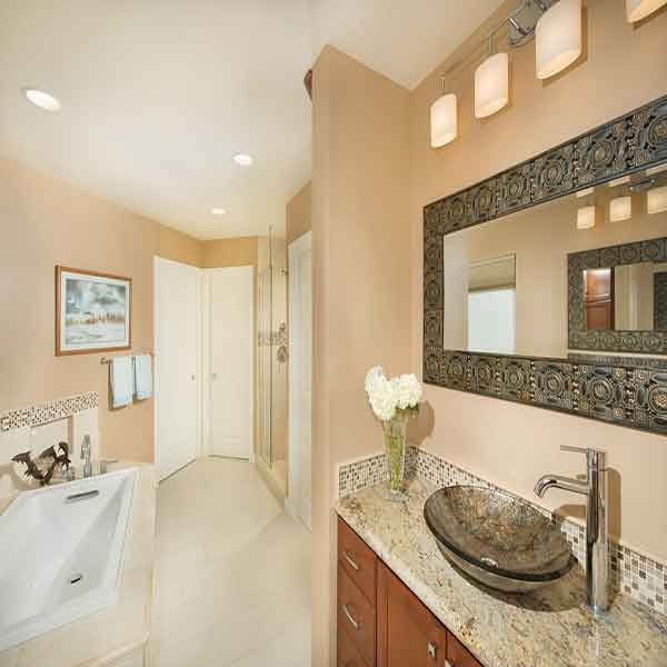 Light colored bathroom with beautiful accents
