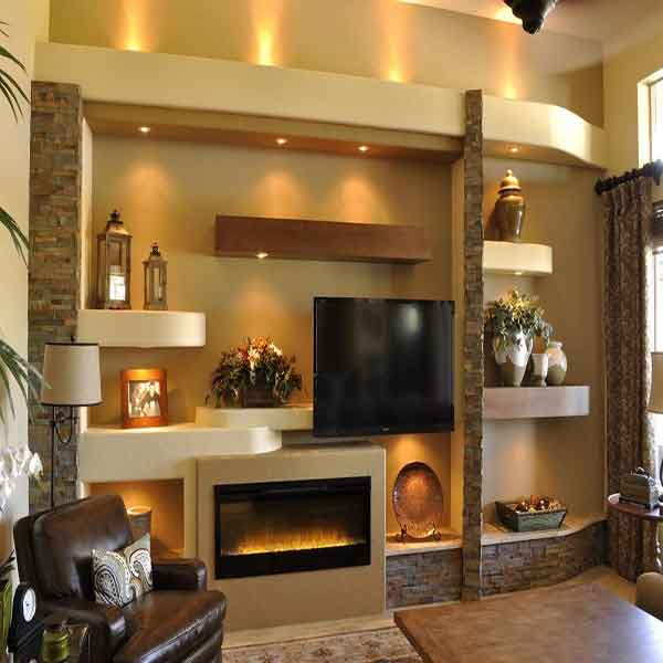 Unusual wall shelving units surrounding a mounted TV