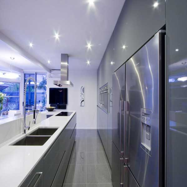 A highly stylized kitchen with brand new appliances